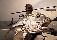 Portraits of fishermen with Jacks and Trevally