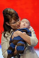 St. Paul, MN - September 3, 2008: Sarah Palin with her son Trig Palin, who has down syndrome at the 2008 Republican National Convention at the Excel Center in St. Paul, Minnesota.