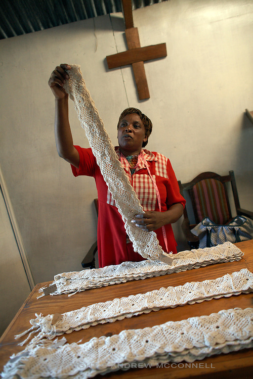 """Finished crochet scarfs produced by the Totoknits group go through quality control at their base in Karinde Anglican Church, in the Dagoretti area of Nairobi, Kenya, in Monday, Jan. 12, 2009. The Totoknits group consists of 150 women who produce crochet hand-bags, cases and scarfs for MAX&Co. The products are part of the company's """"ethical fashion"""" range in Africa which is designed to reduce extreme poverty and empower women. The limited edition collection consists of one-of-a-kind handmade accessories such as shoulder-bags, bracelets, key-rings, belts and scarfs."""