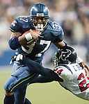 Seattle Seahawks'  running back Shaun Alexander rushes against the Houston Texans on Sunday, Sunday, Oct. 16, 2005 at QWEST Field in Seattle. Jim Bryant Photo. ©2010. All Rights Reserved.