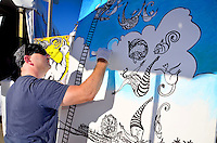 Artist David Russo paints during City to the Sand networking mixer at Perry's Beach Café on Wednesday, June 27, 2012.
