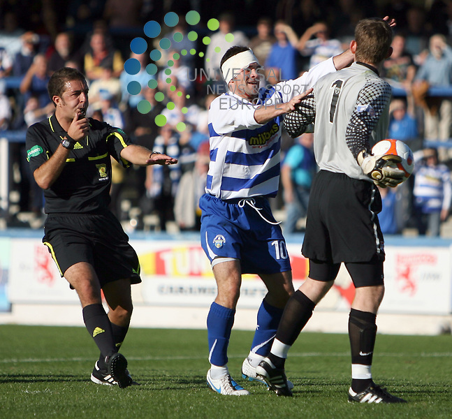 Morton's Stewart Kean tries to get the ball from County keeper Michael McGovern as ref Thomas Robertson moves in to calm things down during The Irn-Bru First Division match between Greenock Morton and Ross County at Cappielow 25/09/10 ..Picture by Ricky Rae/universal News & Sport (Scotland).