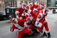 People dressed as santa claus poses for a picture while they take part during the SantaCon party in New York, United States. 15/12/2012. Photo by Kena Betancur/VIEWpress.