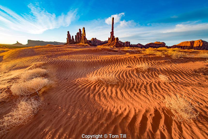 Sand dunes and the Totem Pole and Yei Bi Chei rocks, Monument Valley  Navaho Tribal Park,  Arizona