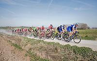 peloton led by Zdenek Stybar (CZE/Quick Step Floors racing over the newly added gravel roads around Ploegsteert, called 'Plugstreets'<br /> <br /> 79th Gent-Wevelgem 2017 (1.UWT)<br /> 1day race: Deinze &rsaquo; Wevelgem - BEL (249km)