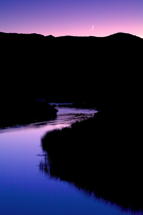 Moon set over the Rio Grande in Colorado's San Luis Valley.