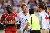 Jimmy Conrad (12)  of the United States (USA) is tended to by the medical staff. The United States (USA) defeated Panama (PAN) 2-1 during a quarterfinal match of the CONCACAF Gold Cup at Lincoln Financial Field in Philadelphia, PA, on July 18, 2009.