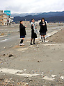 March 11, 2012, Rikuzentakata, Japan - Three sisters visit the empty lot where their home was located a year ago at Rikuzentakata, Iwate Prefecture, some 402 km northeast of Tokyo, on Sunday, March 11, 2012..Memorial ceremonies were held throughout Japan to mark the one year anniversary of the massive earthquake and tsunami that struck the country?fs northeastern region, killing just over 19,000 people and unleashing the world?fs worst nuclear crisis in a quarter century. The quake was the strongest recorded in the nation?fs history, and set off a tsunami that towered more than 65 feet in some spots along the northeastern coast, destroying thousands of homes and wreaking widespread destruction. (Photo by Natsuki Sakai/AFLO) AYF -mis-