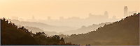 One of my favorite photos of Austin, this panoramas shows the skyline shrouded in a low fog as sun filters through the clouds, turning everything a pastel shade of orange.