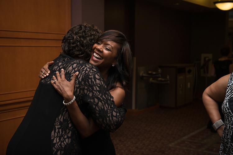 Darlynn Linton, right, hugs former classmate, Melanie Blackwell Marshall, both graduates of Ohio University's class of 1987 during the 2016 Black Alumni Reunion Gala was held at the Baker Center Ballroom on Friday, September 16, 2016.