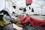 ALEXANDRA, SOUTH AFRICA - MAY 22:  An unidentified man from Zimbabwe rests after being beaten on May 22, 2008 at Alexandra police station outside Johannesburg, South Africa. His shack was burned down during xenophobic attacks in the township a few days earlier. South Africa was rocked by xenophobic violence in May, where tens of thousands of African immigrants were chased out from poor townships and about sixty people were killed. Poor South Africans often have to compete with the ever-increasing African refugees arriving in the country. (Photo by: Per-Anders Pettersson/Getty Images).