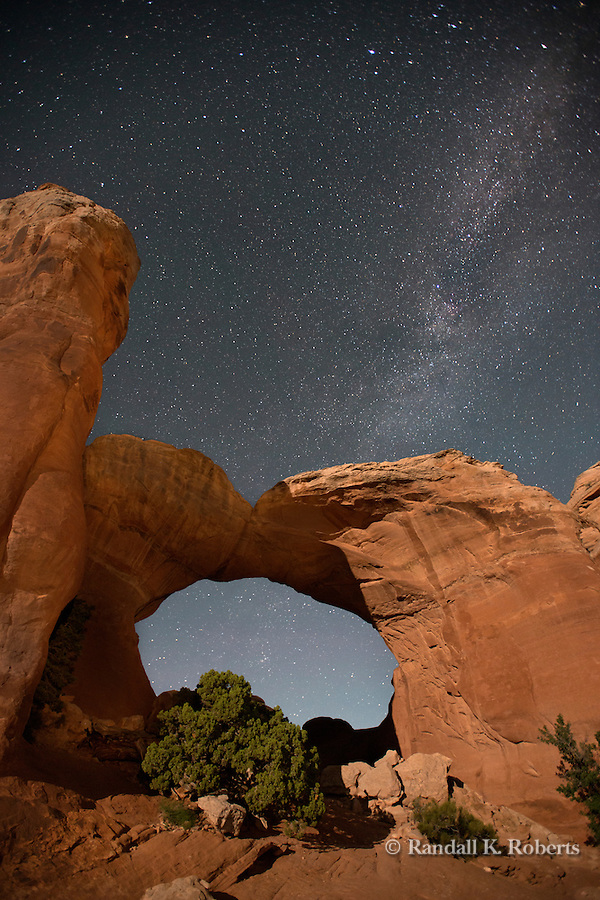 Milky Way and moonlight over Broken Arch, Arches National Park, Utah
