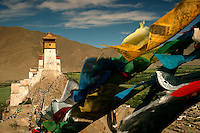 Towering over the Yarlung valley, the Yumbulagang fortress rises from the summit of Mt. Tashitseri on the eastern bank of the Yarlung Tsangpo like a medieval European castle draped in Buddhist prayer flags.