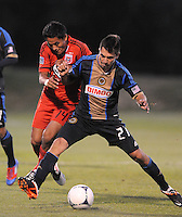 Philadelphia Union midfielder Michael Farfan (21) shields the ball against D.C. United midfielder Andy Najar (14) The Philadelphia Union defeated D.C. United 2-1in extra time at the round of sixteen of the Lamar Hunt U.S. Open Cup at The Maryland SoccerPlex, Tuesday June 6, 2012.