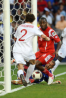 Goalkeeper Milan Borjan Canada makes a vain attempt to stop Luis Tejada Panama scoring te equalizing goal...Canada and Panama played to a 1-1 tie in Gold Cup play at LIVESTRONG Sporting Park. Kansas City Kansas.