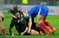 Ma'a Nonu is tackled during the international rugby match between the New Zealand All Blacks and France at Yarrow Stadium, New Plymouth, New Zealand on Saturday, 21 June 2013. Photo: Dave Lintott / lintottphoto.co.nz