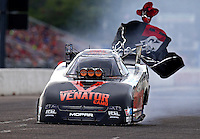 Aug 20, 2016; Brainerd, MN, USA; NHRA funny car driver Matt Hagan deploys his parachutes after setting a new national record with an elapsed time of 3.822 seconds at 333 mph during qualifying for the Lucas Oil Nationals at Brainerd International Raceway. Mandatory Credit: Mark J. Rebilas-USA TODAY Sports