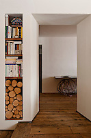 Recessed shelving built into the wall beside the open doorway is both space saving and attractive