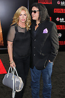 """HOLLYWOOD, LOS ANGELES, CA, USA - MAY 08: Shannon Tweed Simmons, Gene Simmons at the Los Angeles Premiere Of Warner Bros. Pictures And Legendary Pictures' """"Godzilla"""" held at Dolby Theatre on May 8, 2014 in Hollywood, Los Angeles, California, United States. (Photo by Xavier Collin/Celebrity Monitor)"""