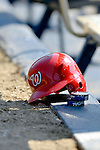 6 March 2006: A batting helmet and chewing tobacco rest on the Nationals' dugout lip during a Spring Training game against the Los Angeles Dodgers. The Nationals and Dodgers played to a scoreless tie at Holeman Stadium, in Vero Beach Florida...Mandatory Photo Credit: Ed Wolfstein..