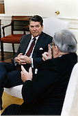 United States President Ronald Reagan listens to Vernon Walters, U.S. Ambassador to the United Nations, in a discussion concerning the response of European allies to the Libyan incident in the Oval Office of the White House in Washington, D.C. on Thursday morning, April 17, 1986..Mandatory Credit: Bill Fitz-Patrick - White House via CNP