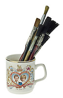 Paint Brushes Stored in a Prince Charles and Princess Diana Royal Wedding Commemorative Mug - Feb 2013.