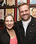 Edie Falco and Stephen Wallem attend the The Robert Whitehead Award presented to Mike Isaacson at Sardi's on May 10, 2017 in New York City.