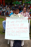 "PALERMO COLOMBIA - APRIL 29: A farmer holds a poster as he attends the ""frutos de mi Tierra"" forum on April 29, 2017 in Palermo, Antioquia. The Anti mining forum it's taking place in the town as environmental concerns arise in reaction of the threat from South African miner AngloGold Ashanti plans to develop a open-pit gold mines in the central Colombian region.  Photo by VIEWpress/Guillermo Betancur"