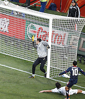 Landon Donovan (R) of USA scores past Slovenia Goalkeeper Samir Handanovic to bring the score back to 2-1
