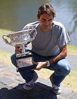 Roger Federer with the Australian Open trophy on the bank of the Yarra River..International Tennis - Australian Open Tennis - Monday 1 Feb 2010 - Melbourne Park - Melbourne - Australia ..© Frey - AMN Images, 1st Floor, Barry House, 20-22 Worple Road, London, SW19 4DH.Tel - +44 20 8947 0100.mfrey@advantagemedianet.com