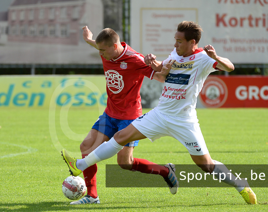 FC Gullegem - Londerzeel SK : Nicolas Gezelle (r) met de tackle op Arne Verhoeven (links) <br /> foto VDB / BART VANDENBROUCKE