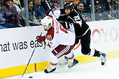 David Schlemko (Phoenix Coyotes, #5) vs Jarret Stoll (Los Angeles Kings, #28) during ice-hockey match between Los Angeles Kings and Phoenix Coyotes in NHL league, March 3, 2011 at Staples Center, Los Angeles, USA. (Photo By Matic Klansek Velej / Sportida.com)