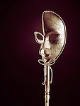 Beautiful Venetian mask isolated on black red background