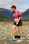 NELSON LAKES, NEW ZEALAND - APRIL 18:  Cyndy Horne crosses the Travers River during the 2015 Alpine Lodge Loop The Lake trail run at Lake Rotoiti on April 18 16, 2015 in Nelson, New Zealand. (Photo by Marc Palmano/Shuttersport Limited)