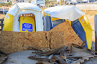 Picture showing damage to two port potties after hurricane Sandy passed through.