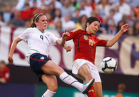 22 MAY 2010:  USA's Heather O'Reilly #9 and Linda Bresonik during the International Friendly soccer match between Germany WNT vs USA WNT at Cleveland Browns Stadium in Cleveland, Ohio. USA defeated Germany 4-0 on May 22, 2010.