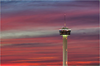 Taken from the top of a building across I-35, this image shows the Tower of the Americas in San Antonio against a beautiful sunset.