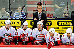 31 March 2010: Carolina Hurricanes Head Coach Paul Maurice looks out from behind the bench during a game against the Montreal Canadiens at the Bell Centre in Montreal, Quebec, Canada. The Hurricanes defeated the Canadiens 2-1. Mandatory Credit: Ed Wolfstein Photo