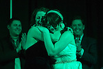 Dr. Brittany Peterson hugs Dr. Stephanie Tikkanen as the judges annouce her the winner of the 2015 Ava Nichols Faculty Pageant. Tikkanen is an assistant professor in the School of Communication Studies.