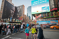 An electronic billboard in Times Square in New York, owned by CBS Outdoor America, shows advertising for Claritan on Tuesday, March 18, 2014. CBS announced that it will spin off its outdoor advertising unit, CBS Outdoor America in an initial public offering valuing the company at $3.3 billion. CBS Outdoor has approximately 330,000 billboards in the United States with 47% in New York. After the IPO CBS will still own 83% of the company. (© Richard B. Levine)