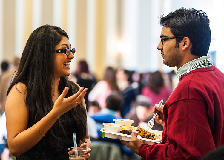 Camila LeMaster talks to Nilesh Shah, 1st year graduate student, at the International Dinner in Baker University Ballroom on Saturday, November 17, 2012. Students of many different races and religions game together to enjoy one night of multicultural food and entertainment.