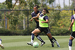 21 August 2009: LA's Han Duan (CHN) (right) and Sharolta Nonen (CAN) (behind). The Los Angeles Sol held a training session at the Home Depot Center in Carson, California one day before playing Sky Blue FC in the inaugural Women's Professional Soccer Championship Game.