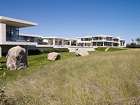 A series of connected, modern pavillions, designed by Brian Sawyer and John Berson, stretch out behind the dunes of this Hamptons coastal retreat