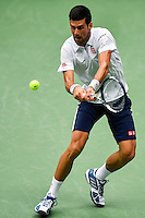 NEW YORK, USA - SEPT 09, Novak Djokovic of Serbia returns a shot against Gael Monfils of France during their Men's Singles Semifinal Match of the 2016 US Open at the USTA Billie Jean King National Tennis Center on September 9, 2016 in New York.  photo by VIEWpress