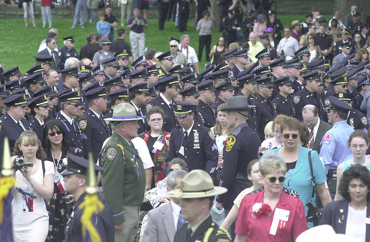 Officers Memorial 3(DG) 051500 -- Families and friends of fallen officers pass by a sea of policemen during the National Peace Officers Memorial Day Service.