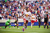 Brandon Barklage (25) of the New York Red Bulls celebrates scoring. The New York Red Bulls defeated DC United 3-2 during a Major League Soccer (MLS) match at Red Bull Arena in Harrison, NJ, on June 24, 2012.