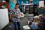 Joe Riofrio looks over bills in his closed store, the Westside Grocery in Mendota, Calif., September 10, 2012.