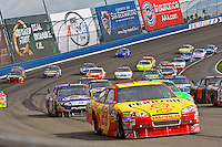 Feb. 21, 2010, Auto Club Speedway, CA: Kevin Harvick leads the field through turn 2 in Fontana, CA.