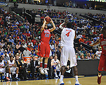 Ole Miss' Marshall Henderson (22) vs. Florida's Patric Young (4) in the SEC championship game at Bridgestone Arena in Nashville, Tenn. on Sunday, March 17, 2013.