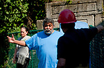 WATERBURY,  CT-051817JS06- Charlie Santiago, who lived on the third floor of 58-60 Lounsbury Street in Waterbury, talks with a fire investigator on Thursday outside his home. His house was one of four that were distorted by fire on Wednesday night. Santiago, who now has to live with his son, said he lost everything except the clothes on his back. <br /> Jim Shannon Republican-American